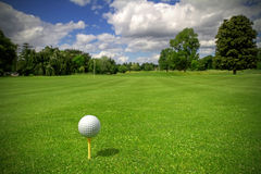 Idyllic golf club. Golf ball on tee in a beautiful golf club Stock Photography