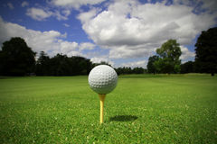 Idyllic golf club. Golf ball on tee in a beautiful golf club Royalty Free Stock Images
