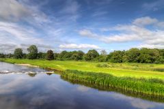 Idyllic golf course. With reflection in the river, Ireland Royalty Free Stock Photo