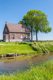 Idyllic house at a small creek Stock Images