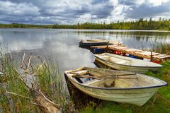 Idyllic lake scenery with boats in cloudy day. Sweden Stock Images