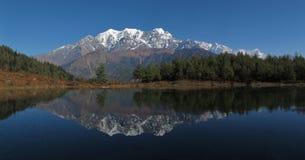 Idyllic Lake Sekong and Nilgiri, Nepal Royalty Free Stock Photos