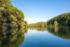 Idyllic lake. Idyllic water landscape, lake with trees around Stock Photo