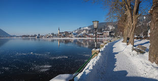 Idyllic lakeside promenade at spa town schliersee, winter landscape. With frozen lake, upper bavaria stock photo