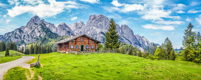 Idyllic landscape in the Alps with mountain chalet Royalty Free Stock Photo