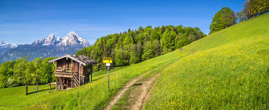Idyllic landscape in the Alps with traditional mountain lodge in spring royalty free stock photos
