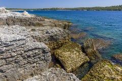 Idyllic landscape in the Brijuni National Park. Rocks on the coast of the Adriatic sea stock photos