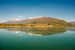 Idyllic landscape with clear mountain lake with mirroring reflection. Clear mountain lake landscape. Mirroring mountain reflection in the lake. Landscape view royalty free stock image