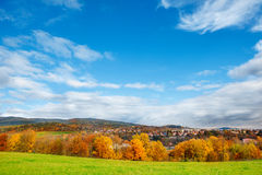 Idyllic  landscape. Idyllic European landscape - town surrounded with autumnal hills and meadows Royalty Free Stock Photography
