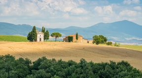 Idyllic landscape with the famous Vitaleta Chapel, in Val d`Orcia, In the italian region of Tuscany. stock images
