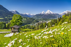 Idyllic Landscape In The Alps In Spring With Traditional Mountain Lodge Stock Photos