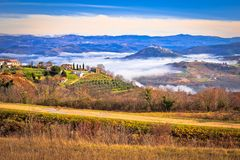 Idyllic landscape of inland Istria in fog view. Towns of Motovun and Vizinada, famous tourist destination of Croatia stock images