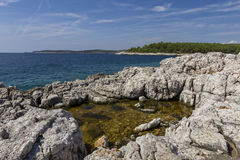 Idyllic landscape in the Kamenjak National Park. Rocks on the coast of the Adriatic sea stock photo