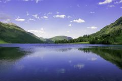 Idyllic landscape of Lake District National Park, Cumbria, UK. UNESCO world heritage side.Beautiful scenery of mountain valley with cristal clear lake in spring stock images