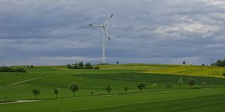 Idyllic Landscape with Modern Windmill Stock Photos