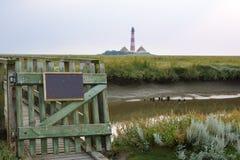 Idyllic Landscape of North Sea region with lighthouse Stock Photo
