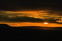 Idyllic landscape of Peak District National Park, Derbyshire, Uk. Red sunset over silhouetted hills and dramatic sky with dark clouds.Magic hour scene.Dusk in royalty free stock photos