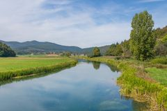 Idyllic landscape view of riverbanks of gacka in central croatia. Europe stock photography