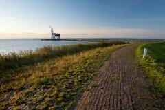Idyllic lighthouse from the dike at sunrise Stock Image
