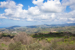 Idyllic Mediterranean landscape with mountains, clouds, trees an Royalty Free Stock Photos
