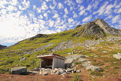 Idyllic mountain hut Stock Photography