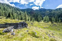Idyllic mountain landscape in the alps: Ruin of a chalet, meadows and forest. Ruin of a chalet in Austria: Idyllic landscape in the Alps mountain hut pasture royalty free stock images