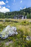 Idyllic mountain landscape in the alps: Ruin of a chalet, meadows and forest. Ruin of a chalet in Austria: Idyllic landscape in the Alps mountain hut pasture stock images