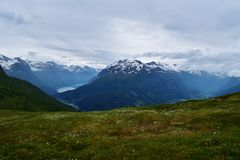 Idyllic mountain range with a pure fjord lake, in Norway. Royalty Free Stock Image