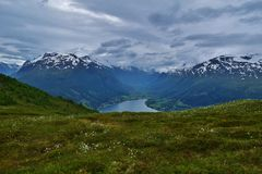 Idyllic mountain range with a pure fjord lake, in Norway. Snowy mountains near Loen, Norway. 2015 Stock Image