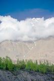 Idyllic Mountain Valley. Sunrise over mountain peak Northern area of Pakistan Stock Photo