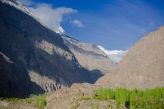 Idyllic Mountain Valley. Sunrise over mountain peak Northern area of Pakistan Royalty Free Stock Images