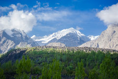 Idyllic Mountain Valley. Sunrise over mountain peak Northern area of Pakistan Royalty Free Stock Photography