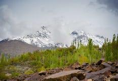 Idyllic Mountain Valley. Sunrise over mountain peak Northern area of Pakistan Stock Images