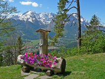Idyllic mountainous scenery with flower trough Royalty Free Stock Images