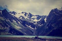 Idyllic mountains landscape lake with water reflections Stock Image