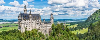 The idyllic Neuschwanstein Castle. Hohenschwangau, Germany - June 10, 2018: The idyllic Neuschwanstein Castle positioned high up on a mountain in the Bavarian royalty free stock image