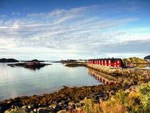 Scandinavia, Norway, Nordic Rugged Landscape, Lofoten Islands. Idyllic Norwegian Fjord with typical red log cabins on Lofoten Islands, Norway. Scandinavia stock photos