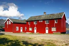 Scandinavia, Norway, Nordic Rugged Landscape, Lofoten Islands. Idyllic Norwegian Fjord with typical red log cabins on Lofoten Islands, Norway. Scandinavia stock image
