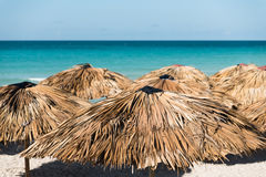 Idyllic ocean view with focus on straw shades Stock Image