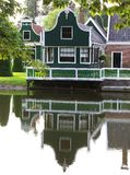 Characteristic ancient wooden Dutch house along canal, Zaanse Schans, Netherlands  Stock Photo