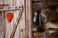 Idyllic outhouse with heart symbol and petrol lamp royalty free stock images