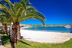 Idyllic palm beach in Primosten Stock Image