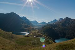 Idyllic panoramic in val piora. surrounded by mountains range in a sunny day. Swiss alps, Ticino royalty free stock images