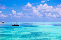 Idyllic perfect turquoise water at exotic island Stock Photos
