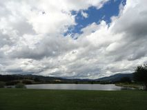 Fluffy Clouds Float in a Crisp Blue Sky near McCall, Idaho Royalty Free Stock Photos