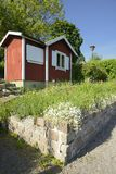 Idyllic red cottage in botanical garden Stock Images