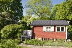 Idyllic red cottage Stock Images