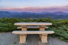Free Idyllic Rest Place With Stone Bench And Table Royalty Free Stock Photography - 164925937