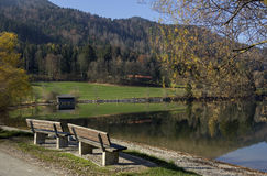 Idyllic resting place at lake shore schliersee, autumnal landsca Royalty Free Stock Photos
