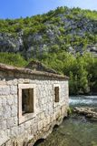 Idyllic river atmosphere. Ruins of old grain mill on river Ruda near town Trilj and Sinj in croatia Stock Photos